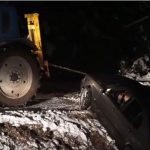 Pulling car out of ditch goes wrong
