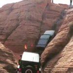 Jeeps climb steep cliff